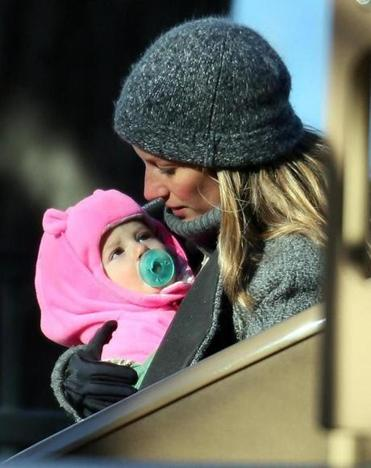 Gisele Bundchen (holding 1-year-old daughter Vivian) joined her husband and the rest of the family at the playground.